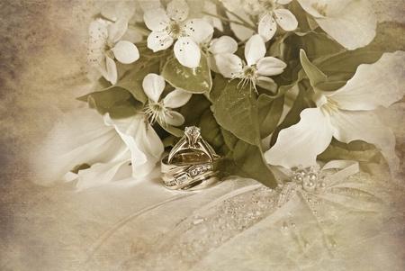 trillium: Wedding rings with trillium bouquet on pillow. Stock Photo