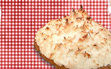 gingham: Coconut cream pie on red gingham background. Stock Photo