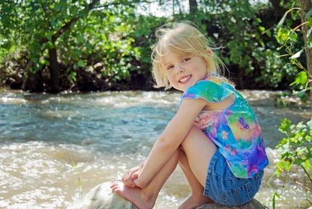 river: child on river rock