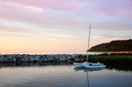 Catamaran in cove at sunset. photo