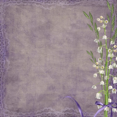 edge: Purple bow on lily of the valley bouquet.