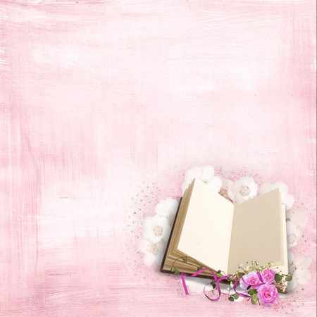 Pink roses and book on textured background.