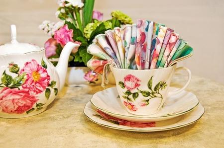 Antique teacup set with floral bouquet.