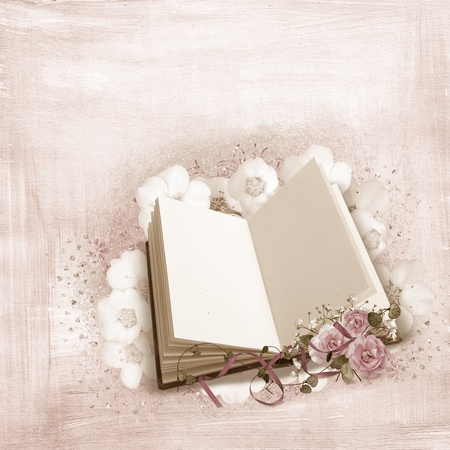 open book with roses and ribbon textured background photo