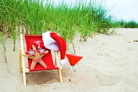 tropical christmas: Christmas starfish in beach chair Stock Photo