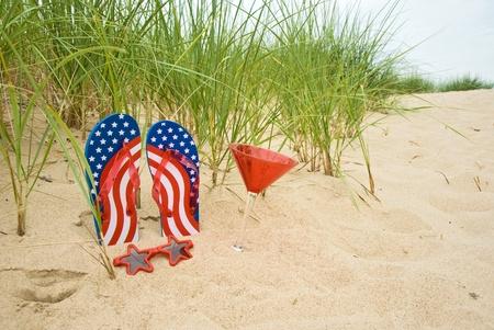 flag flip-flops in sand photo