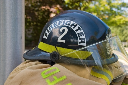 firefighter helmet on coat Stock Photo