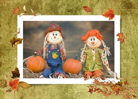 autumn scarecrow: autumn scarecrow couple in fall foliage frame