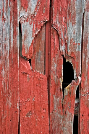 black hole: weathered red barn siding