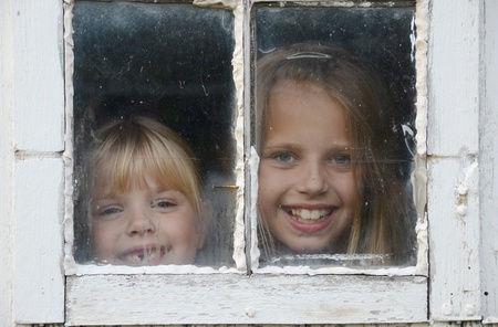 dirty blond: little girls peeking in old barn window
