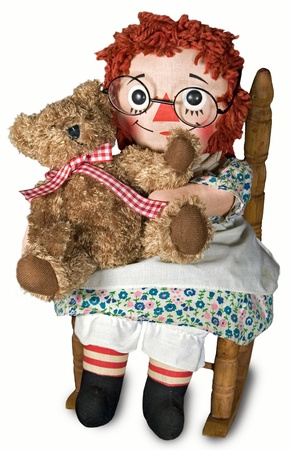 Rag doll with teddy bear in rocking chair. Stock Photo - 10850453