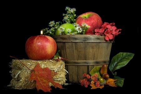 bushel: Candle in autumn apple with bushel basket. Stock Photo