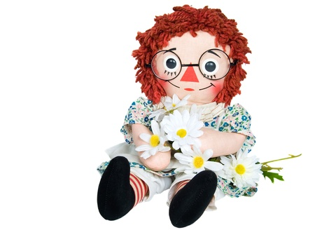 rag doll: Rag doll with daisies on white background. Stock Photo