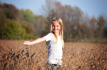 Young girl in soybean field.