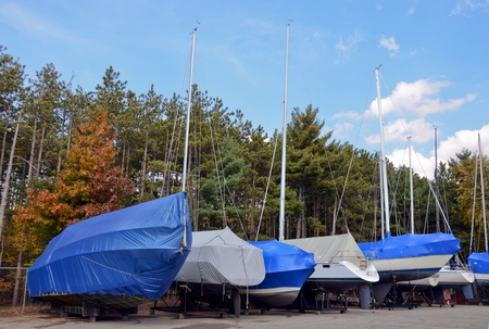 Winterized boats with protective covers. Stock Photo