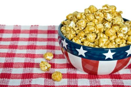 Caramel corn in patriotic bowl. Stock Photo