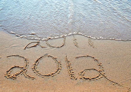 2012 new year in sand Stock Photo - 10952885