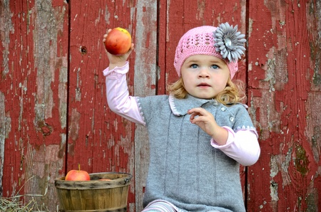 Little girl with apple. Stock Photo - 11154970