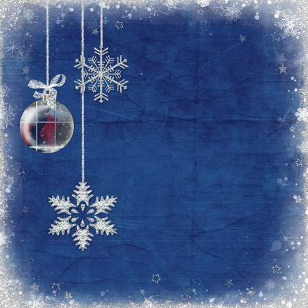 tinsel: Snowflakes and ornament hanging from tinsel.
