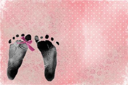 newborn footprint: pink bow on newborn footprint