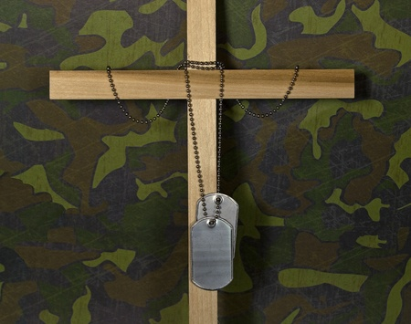 cross armed: Military dog tags on a cross.