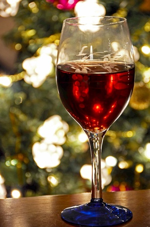 stemware: red wine in glass by holiday tree
