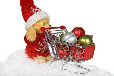 Teddy bear with a shopping cart. photo