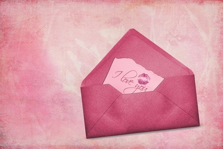 Valentine love note in pink envelope.