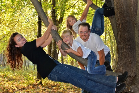 American family in autumn woods photo