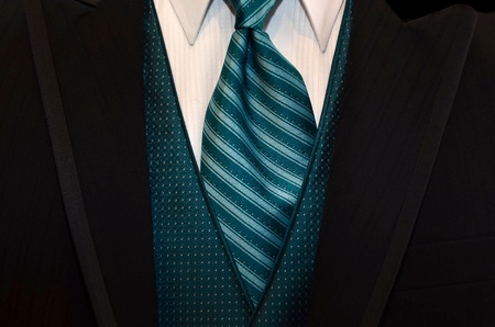 teal tie accenting a black tuxedo