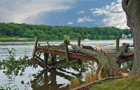 water damage: Oak tree crushing boat dock  Stock Photo