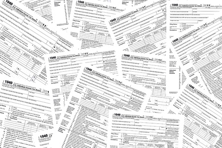 tax form: Scattered income tax form background  Stock Photo