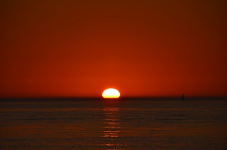 Sun setting over Lake Michigan  photo