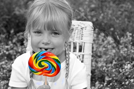 sucker: Little girl with colorful big sucker in selective color  Stock Photo