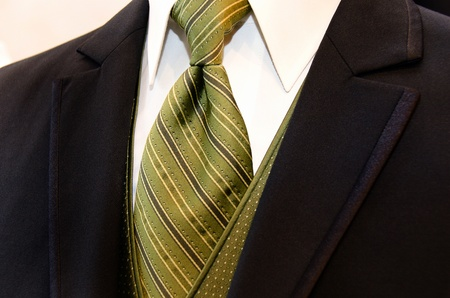 olive green: Rich brown tuxedo with striped silk tie