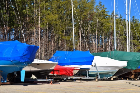 colorful covers on sail and power boats