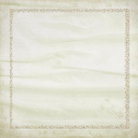 gold sparkling frame on soft textured background