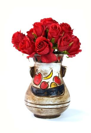 red roses in vintage flower vase