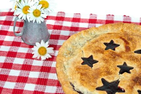 raspberry pie with daisy bouquet Stock Photo