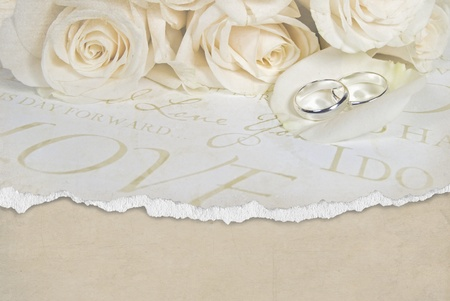 torn wedding paper with rings photo