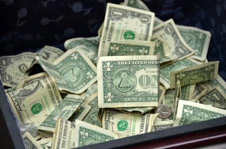 dollar tips in box photo