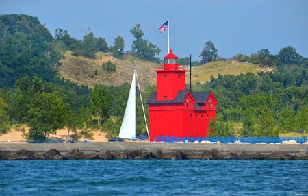 bright red lighthouse on Lake Michigan