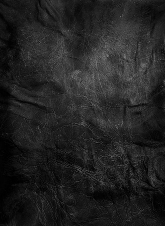black textured background: worn black leather background Stock Photo