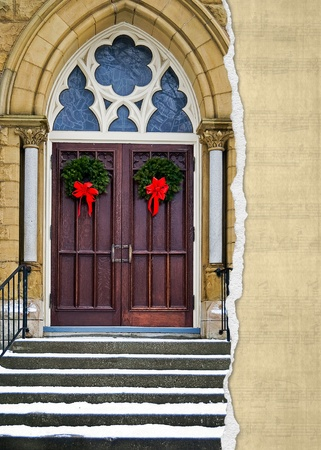 Christmas wreaths on cathedral door with torn border photo