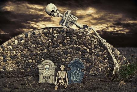 night: skeleton climbing over cemetery wall