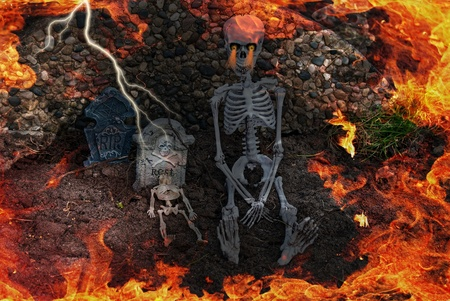 hades: flames in cemetery with skeletons Stock Photo