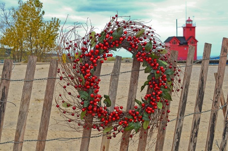 Christmas berry wreath with red lighthouse