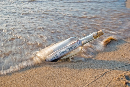 New Year s message in a bottle on the beach photo