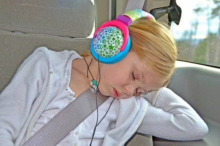 snooze: little girl sleeping with headphone on
