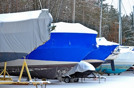 power boat: boats with protective covers in snow